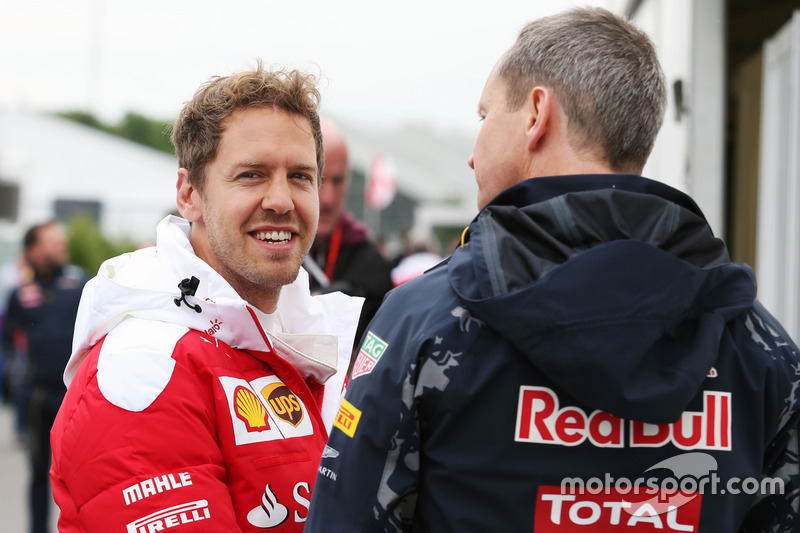 (L to R): Sebastian Vettel, Ferrari with Paul Monaghan, Red Bull Racing Chief Engineer