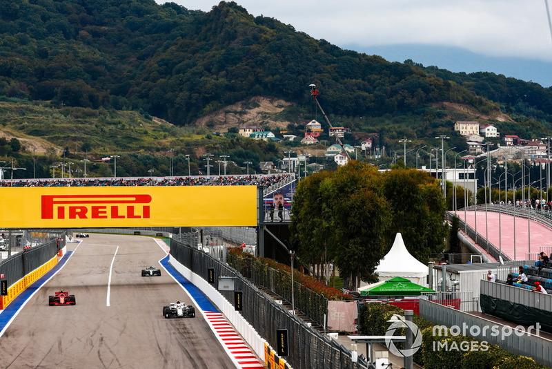Charles Leclerc, Sauber C37, leads Kimi Raikkonen, Ferrari SF71H, and Valtteri Bottas, Mercedes AMG F1 W09