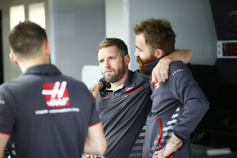Haas team members at work in the team's garage