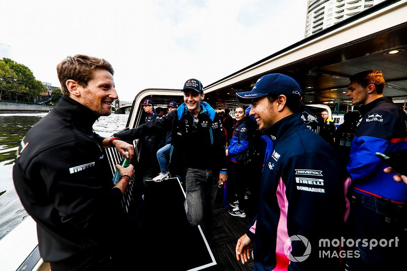 Romain Grosjean, Haas F1 Team, George Russell, Williams and Sergio Perez, Racing Point on the way to the Federation Square event