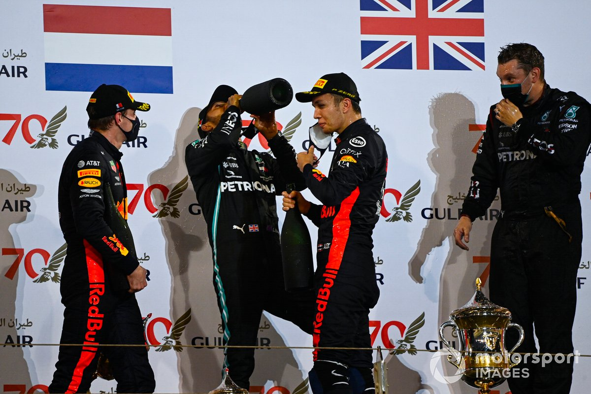Max Verstappen, Red Bull Racing, 2nd position, Lewis Hamilton, Mercedes-AMG F1, 1st position, and Alex Albon, Red Bull Racing, 3rd position, on the podium