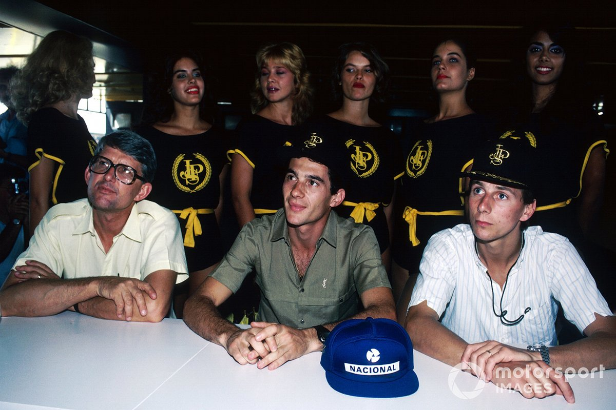 A Lotus press conference: Peter Warr, Lotus Team Manager, Ayrton Senna, and team mate Johnny Dumfries