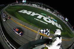 Denny Hamlin, Joe Gibbs Racing Toyota, takes the checkered flag to win the Monster Energy NASCAR Cup Series Can-Am Duel 2