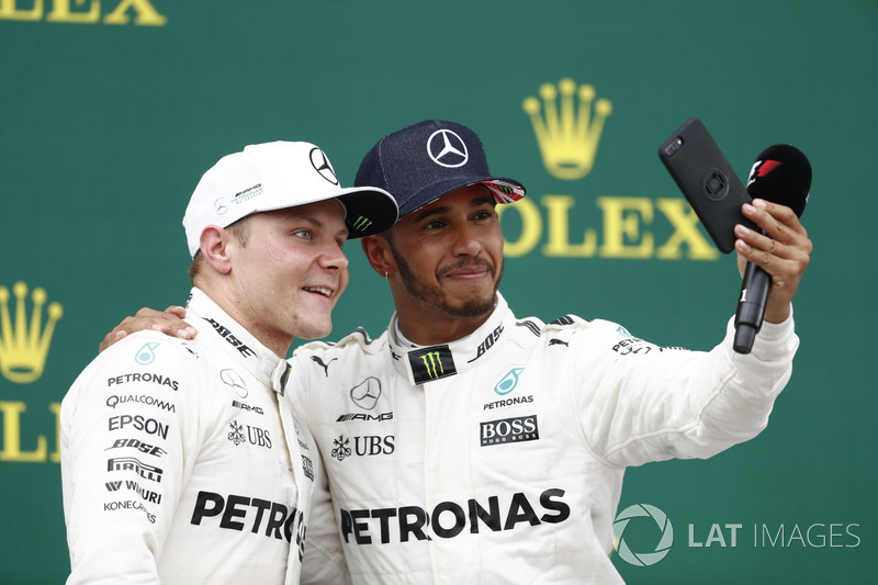 Podium:  Race winner Lewis Hamilton, Mercedes AMG F1, takes a photo of Second place Valtteri Bottas, Mercedes AMG F1