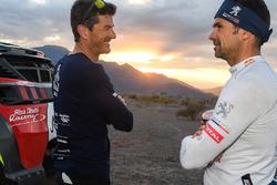 Спортивный директор ралли «Дакар» Марк Кома и гонщик Peugeot Sport Сириль Депре