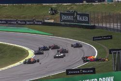 Daniel Ricciardo, Red Bull Racing RB13 and Stoffel Vandoorne, McLaren MCL32 collide at the start of the race