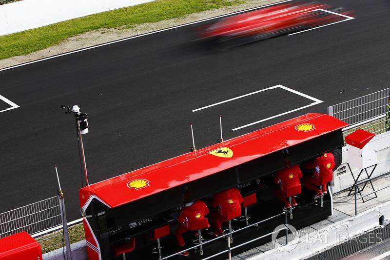Sebastian Vettel, Ferrari SF71H, flashes past his pit wall gantry