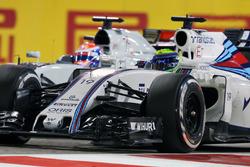 Felipe Massa, Williams FW38 and Romain Grosjean, Haas F1 Team VF-16 battle for position