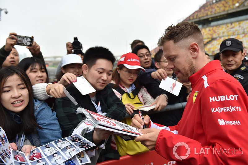 Sebastian Vettel, Ferrari signs autographs for the fans