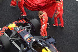 Sebastian Vettel, Ferrari watches the Red Bull Racing RB14