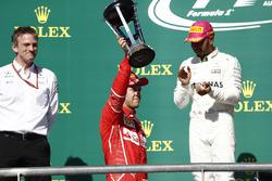 Second place Sebastian Vettel, Ferrari, lifts his trophy on the podium