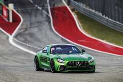 Lewis Hamilton, Mercedes AMG F1, drives a Mercedes SLS around the track with Usain Bolt in the passenger seat