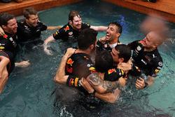 Race winner Daniel Ricciardo, Red Bull Racing celebrates with the team in the Red Bull Racing Energy Station swimming pool