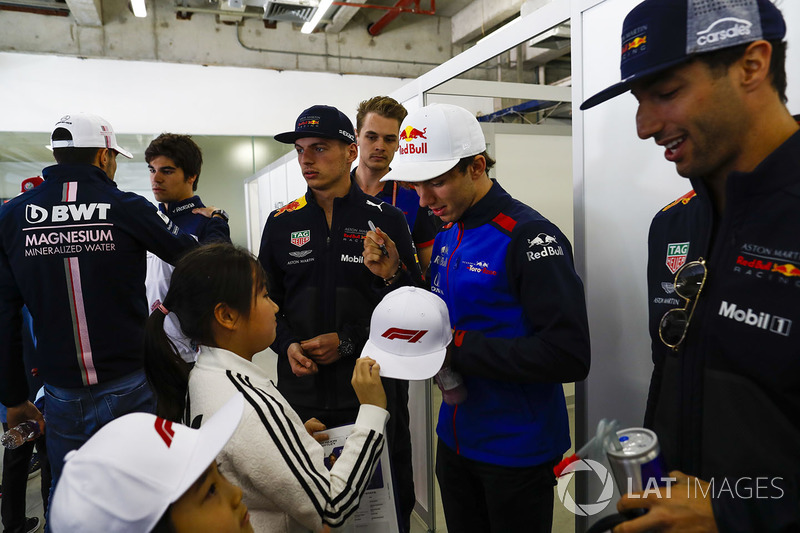 Pierre Gasly, Toro Rosso, signs an autograph for a young fan