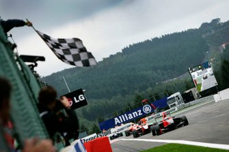 Adrien Tambay, Manor Racing, celebrates victory as he takes the chequered flag in front of Alexander Rossi, ART Grand Prix, and Miki Monras, MW Arden