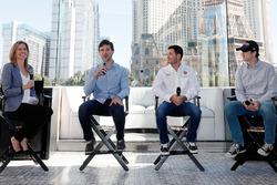 Reporter Kelli Stavast hosts a panel discussion with drivers Daniel Suarez, Kyle Larson and Ryan Bla
