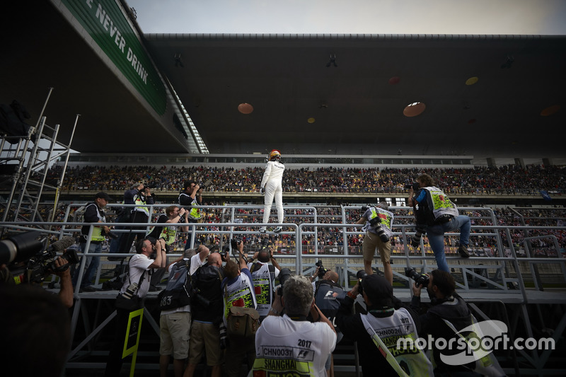 Pole man Lewis Hamilton, Mercedes AMG, celebrates with the fans