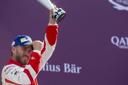 Nick Heidfeld, Mahindra Racing, celebrates on the podium
