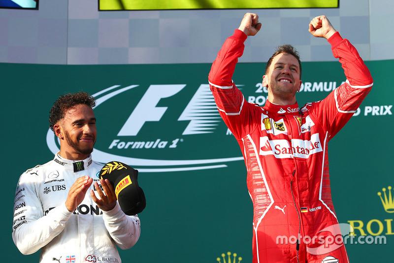Sebastian Vettel, Ferrari; Lewis Hamilton, Mercedes AMG F1