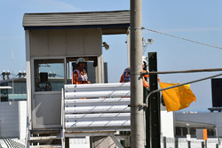 Marshals wave the yellow flag
