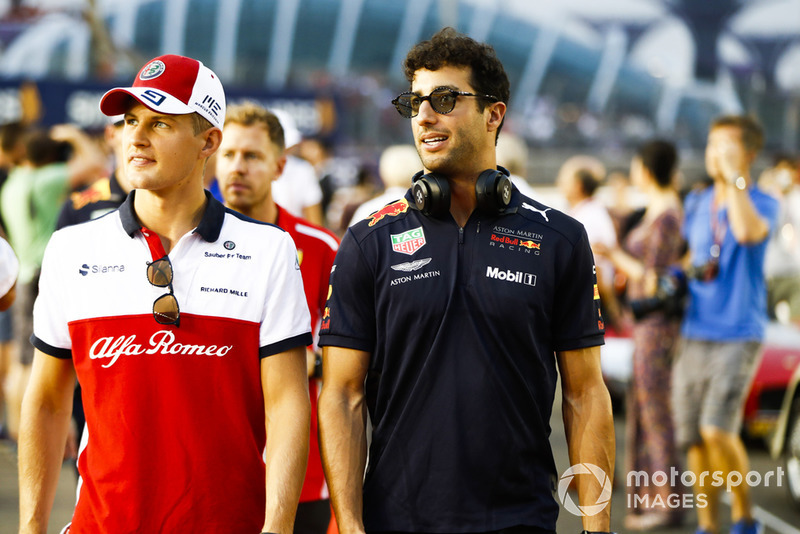 Marcus Ericsson, Sauber, and Daniel Ricciardo, Red Bull Racing, at the drivers parade