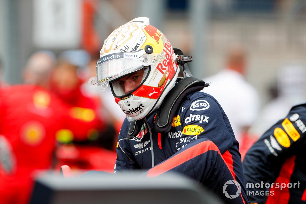 A red faced Max Verstappen, Red Bull Racing, climbs out of his crashed car on the grid