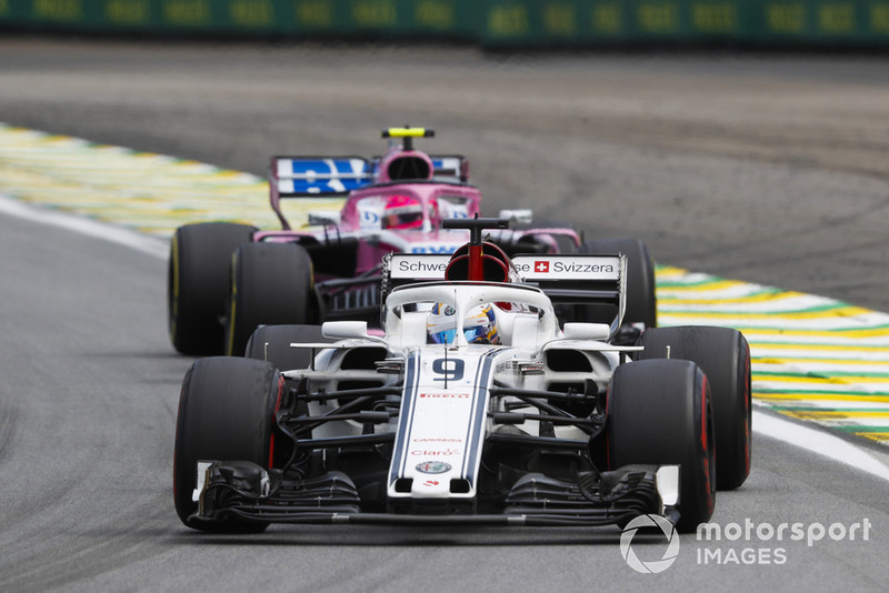 Marcus Ericsson, Sauber C37, leads Esteban Ocon, Racing Point Force India VJM11