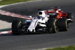 Felipe Massa, Williams FW40, leads Sebastian Vettel, Ferrari SF70H