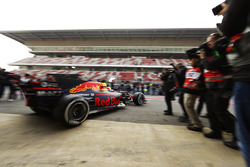 Daniel Ricciardo, Red Bull Racing RB13, passes a throng of photographers as he exits his pit garage
