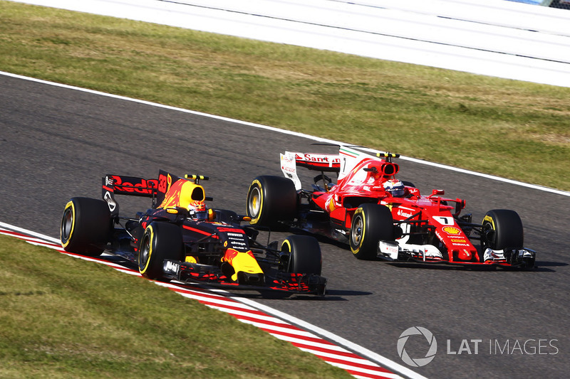 Max Verstappen, Red Bull Racing RB13, battles with Kimi Raikkonen, Ferrari SF70H, after his pit stop