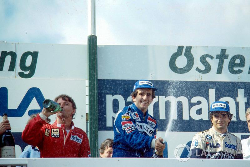 Podium: race winner Alain Prost, second place René Arnoux, third place Nelson Piquet