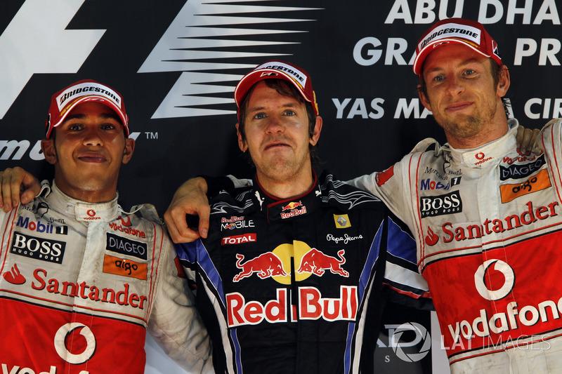 Podium: winnaar Sebastian Vettel, Red Bull Racing, tweede Lewis Hamilton, McLaren, derde Jenson Butt
