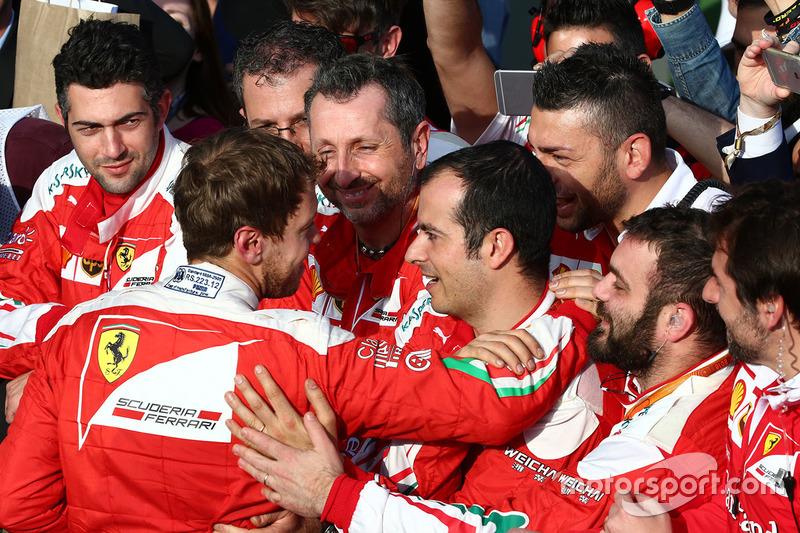 Third place Sebastian Vettel, Ferrari in parc ferme with his team
