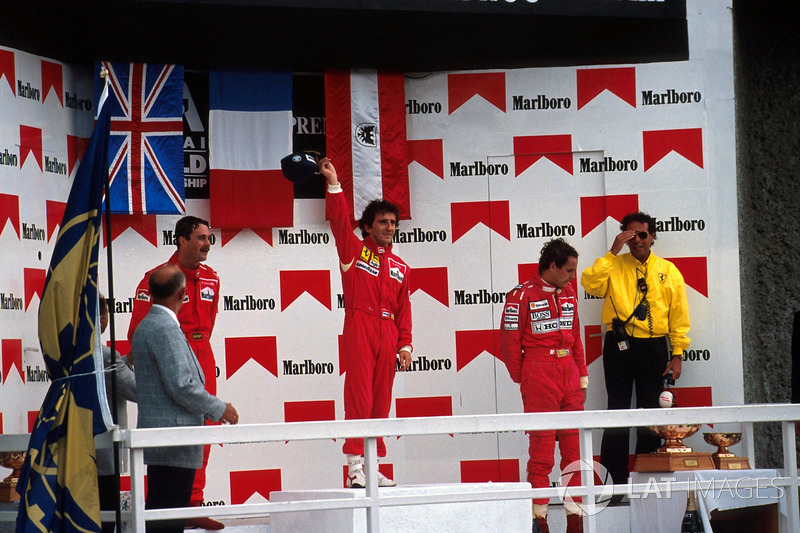 Podium: race winner Alain Prost, second place Nigel Mansell, third place Gerhard Berger