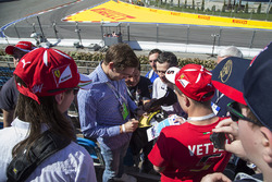Vitaly Petrov, signs autographs for the fans