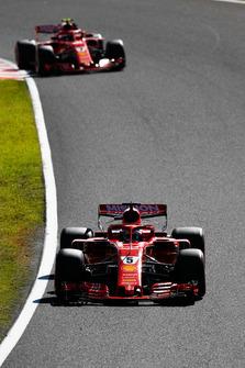 Sebastian Vettel, Ferrari SF71H, leads Kimi Raikkonen, Ferrari SF71H
