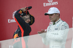 Race winner Daniel Ricciardo, Red Bull Racing celebrates, Valtteri Bottas, Mercedes AMG F1 on the podium and does a shoey, the champagne