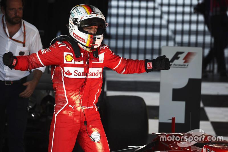 Себастьян Феттель, Ferrari, святкує перемогу в гонці