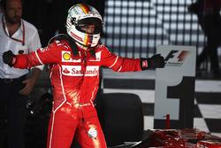 Sebastian Vettel, Ferrari, celebrates after winning the race