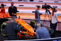 Media gather around the McLaren MCL32