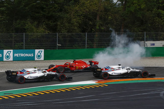 Sebastian Vettel, Ferrari SF71H facing the wrong way after making contact with Lewis Hamilton, Mercedes AMG F1 W09 while Lance Stroll, Williams FW41, Sergey Sirotkin, Williams FW41