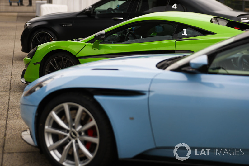 Detail of an Aston Martin DB11, McLaren 570S and AMG Mercedes