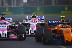 Stoffel Vandoorne, McLaren MCL33 Renault, Sergio Perez, Force India VJM11 Mercedes, and Esteban Ocon, Force India VJM11 Mercedes, at the start