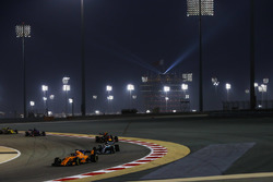 Fernando Alonso, McLaren MCL33 Renault, leads Lewis Hamilton, Mercedes AMG F1 W09, and Max Verstappen, Red Bull Racing RB14 Tag Heuer