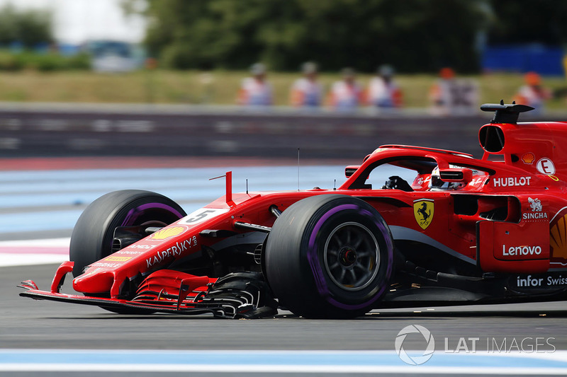 Sebastian Vettel, Ferrari SF71H, returns to the pits with a broken front wing