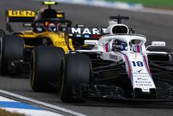 Lance Stroll, Williams FW41, precede Carlos Sainz Jr., Renault Sport F1 Team R.S. 18