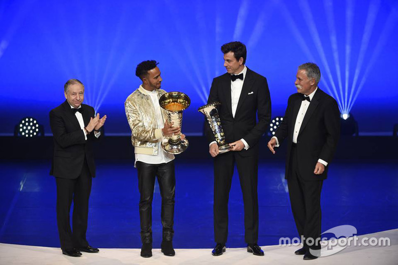 Lewis Hamilton with Toto Wolff, Jean Todt and Chase Carey