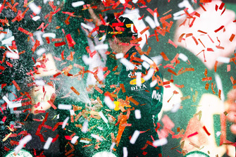 Confetti falls as Max Verstappen, Red Bull Racing, 1st position, celebrates with Champagne on the podium