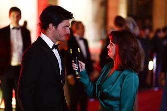 Carlos Sainz Jr. Being interviewed on the red carpet