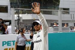 Pole winner Lewis Hamilton, Mercedes AMG F1, waves to fans